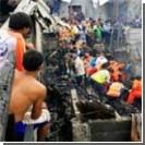 Военный самолет рухнул на жилой квартал, есть жертвы