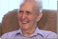 105-летний любитель виски спустился с отвесной стены на веревке