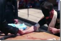 Боевики ИГ отрубили двум мальчикам руки за отказ казнить пленных