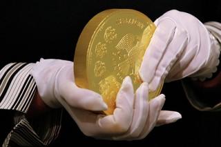 Путин заверил французов в росте золотовалютных резервов России