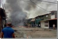 Венесуэльские протестующие сожгли дом Уго Чавеса