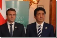 Премьер Японии и президент Франции обсудили сотрудничество с Россией