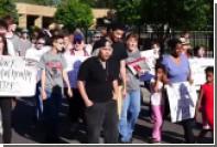 Американцы вышли на акцию протеста из-за раненного полицейским негра