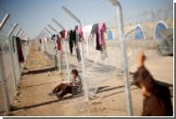 Переодетый в женщину смертник убил 14 человек в иракском лагере беженцев
