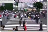 Скрывавшийся от полиции японский водитель проехал через толпу людей