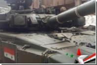 Прошедшие по Красной площади танки появились в Сирии