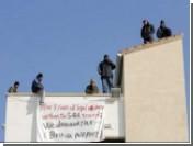 Иракские нелегалы шантажируют британцев групповым прыжком с башни