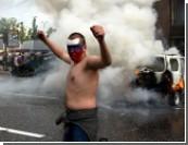 Больные, но не  футболом / Российские фанаты пугают милицию, психологов и политологов