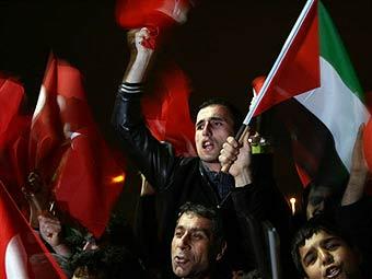 Турецкий премьер стал национальным героем после перепалки с Пересом