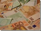 Гривна отвоевывает у доллара копейку за копейкой. Зато проигрывает их евро