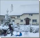 Снежный хаос в Британии: аэропорты закрыты, дороги замело. ФОТО