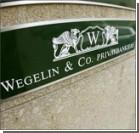 Старейший швейцарский банк закрывается из-за скандала в США