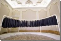 Kiton показал на выставке моды изорванные лохмотья