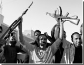 Александр Рар: Каддафи может показать Западу кукиш
