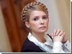 Тимошенко, поздравляя женщин, ныла о «хрупких плечах» и не оправдавших надежд мужчинах