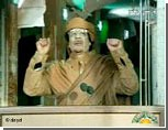 """Западные СМИ о войне в Ливии / Одни говорят о бегстве Каддафи, другие """"передают"""" власть повстанцам"""
