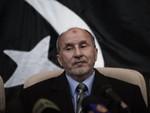Повстанцы пообещали освободить Каддафи от уголовного преследования