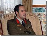 """Ливийское ТВ показало  """"убитого"""" сына Каддафи"""
