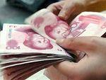 Саркози предложил включить юань в корзину валют МВФ