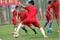 Китайских школьников обучат теории футбола