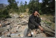 Число жертв землетрясения в Китае достигло 21 тысячи человек