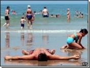 Ученые считают, что втирание солнцезащитного крема создает для кожи большую опасность