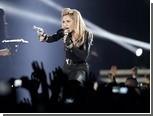 Французские националисты засудят Мадонну за свастику на лбу Ле Пен