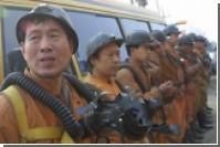В затопленной китайской шахте пропали 172 горняка