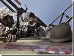 Повстанцы и войска Каддафи вступили в бой у границы с Тунисом
