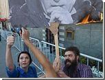 Сжегших портрет Путина активистов осудили за сопротивление полиции