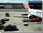Оператор по обработке багажа нашел в самолете крокодила