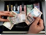 Украинская гривна обвалилась к доллару до трехлетнего минимума