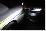 Делавшая топлес-селфи за рулем американка врезалась в полицейскую машину