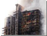 При пожаре в шанхайском небоскребе погибли восемь человек