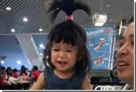 Огромная шевелюра прославила сингапурскую девочку