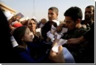 Жителей Мосула вынудили бороться за гуманитарную помощь