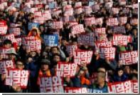 Десятки тысяч человек вышли на митинг за отставку президента Южной Кореи