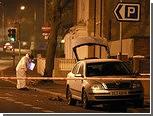 В Белфасте люди в масках подожгли полицейскую машину